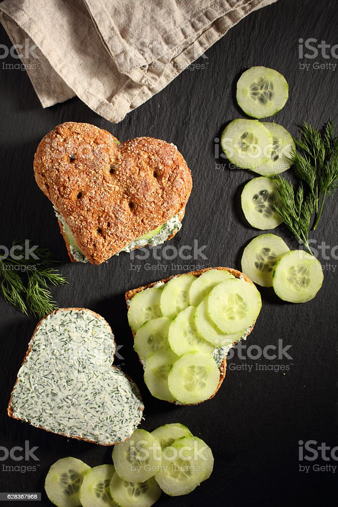 Heart shaped sandwiches with cream cheese stock photo
