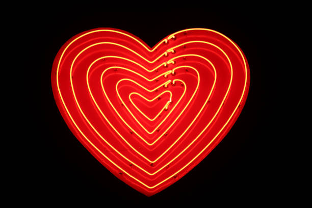 heart shaped sign illuminated - abstract logo stock photos and pictures