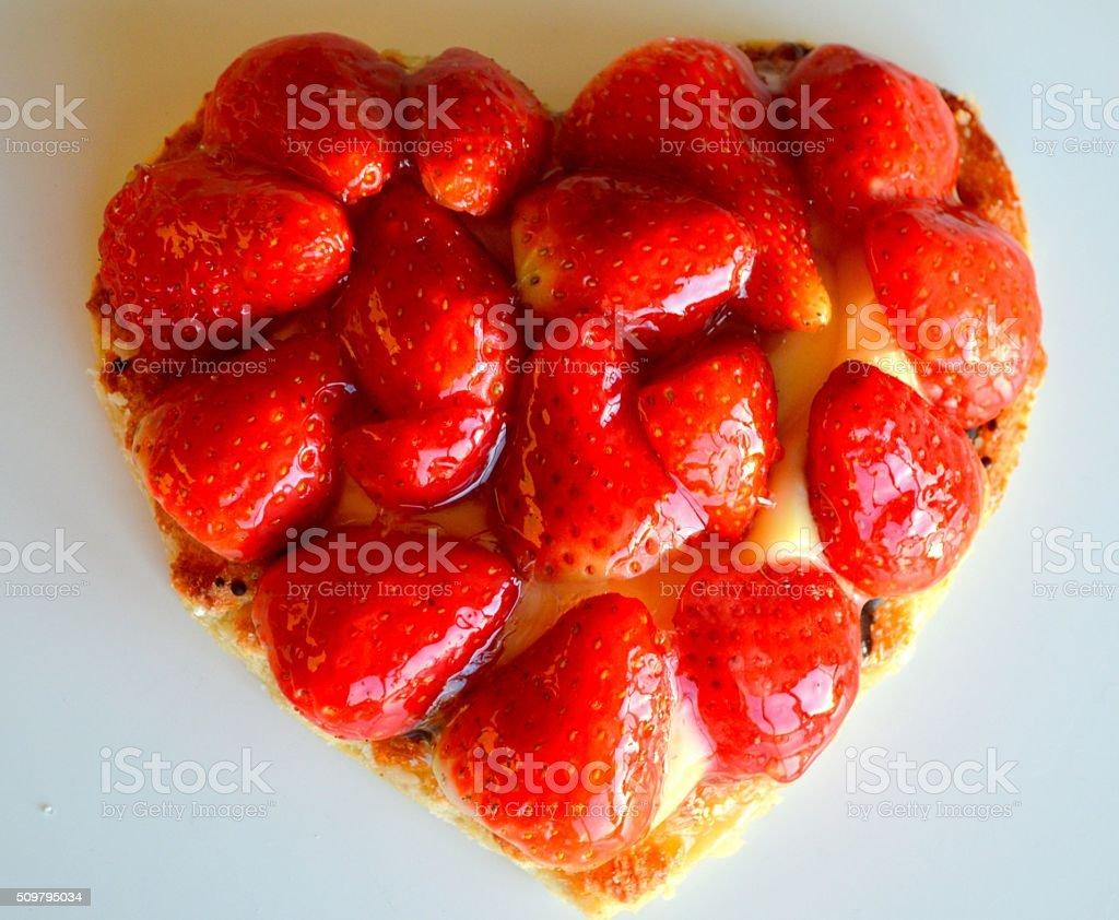 Heart shaped srawberry cake stock photo