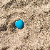 heart shaped stone on beach.