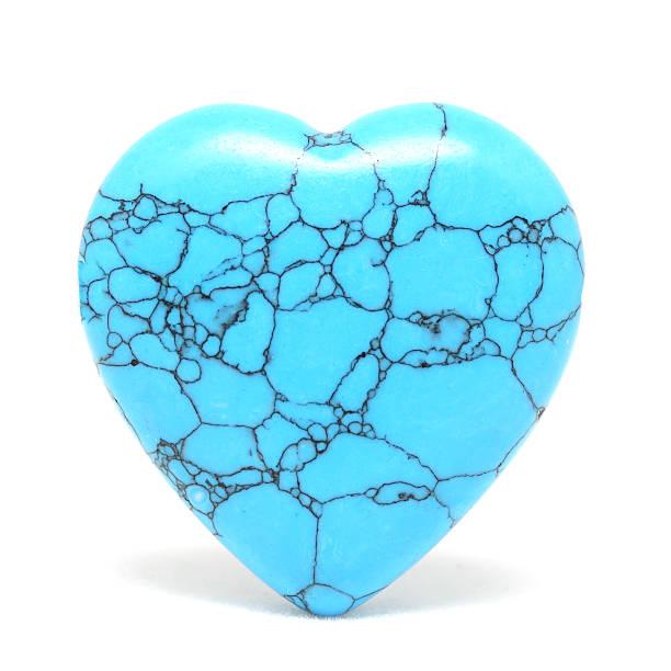 Heart shaped turquoise stone on white background stock photo