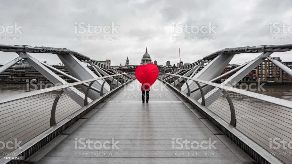 Heart shaped umbrella on bridge in London, UK.2 stock photo