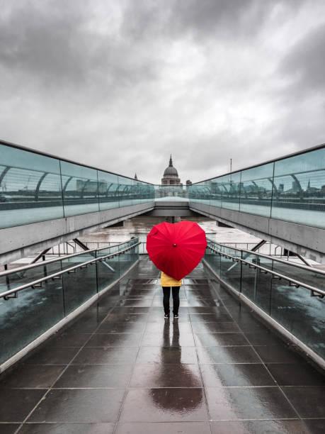 Heart shaped umbrella on bridge in London, UK.2 stock photo