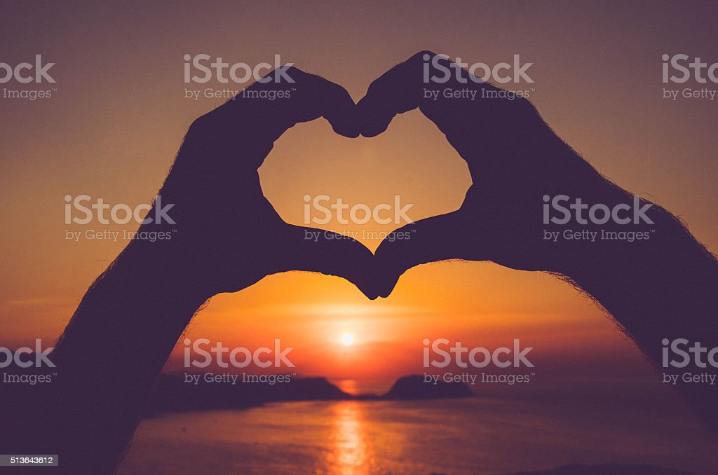 Heart Silhuette made with hands - Sunset in Spain stock photo