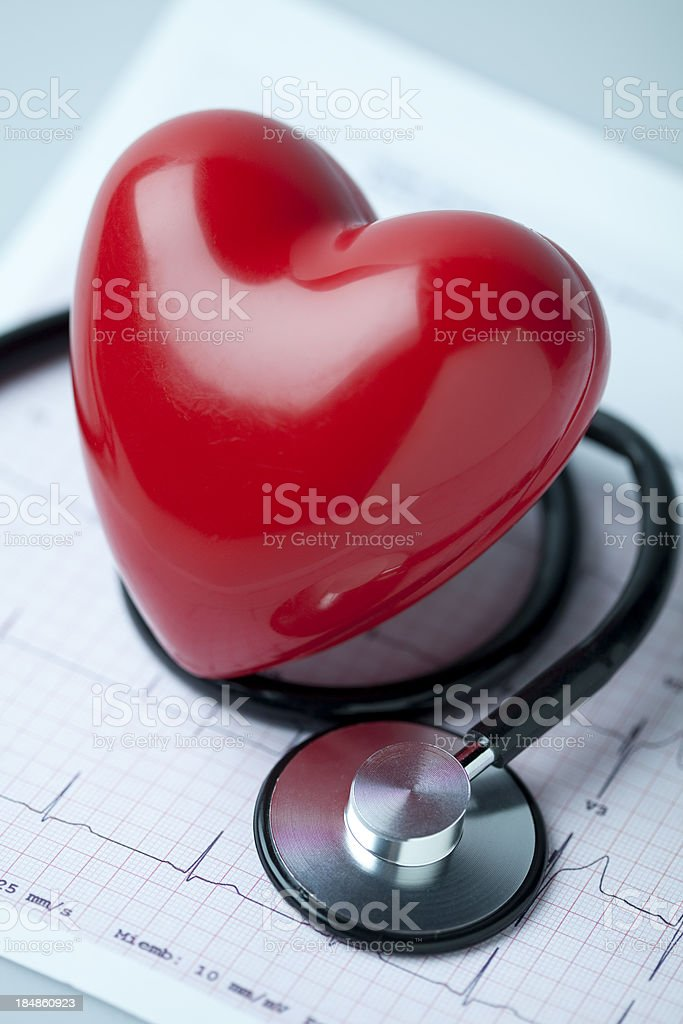 Heart, stethoscope and EKG stock photo