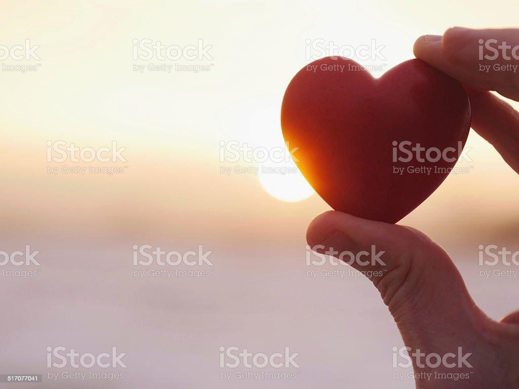 heart sunset love stock photo
