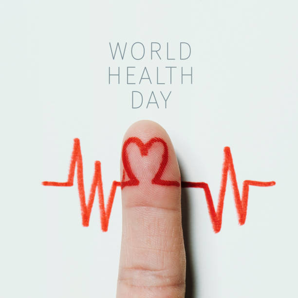 heart symbol and the text world health day a red heart symbol in the forefinger of a man as in an electrocardiogram painted on a white background and the text world health day world health day stock pictures, royalty-free photos & images