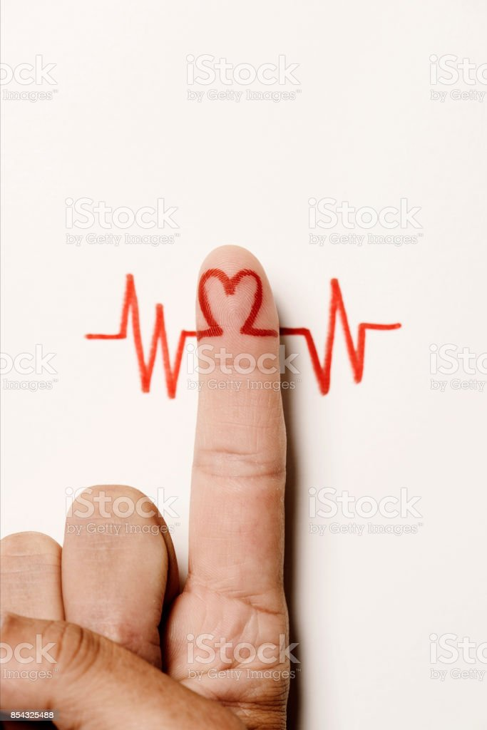 heart symbol in the forefinger of a man stock photo