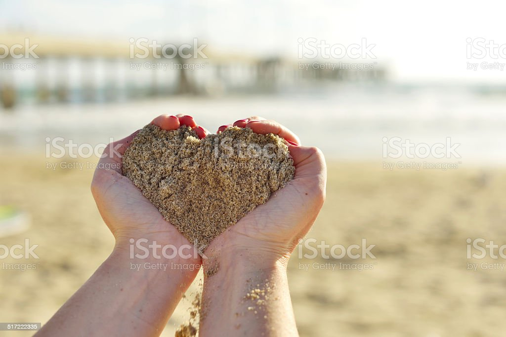 Heart symbol made from sand stock photo