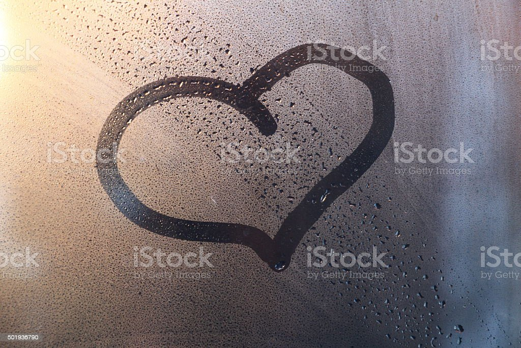 Heart symbol of love drawn on the glass stock photo