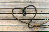 Heart symbol of love, formed of black rope