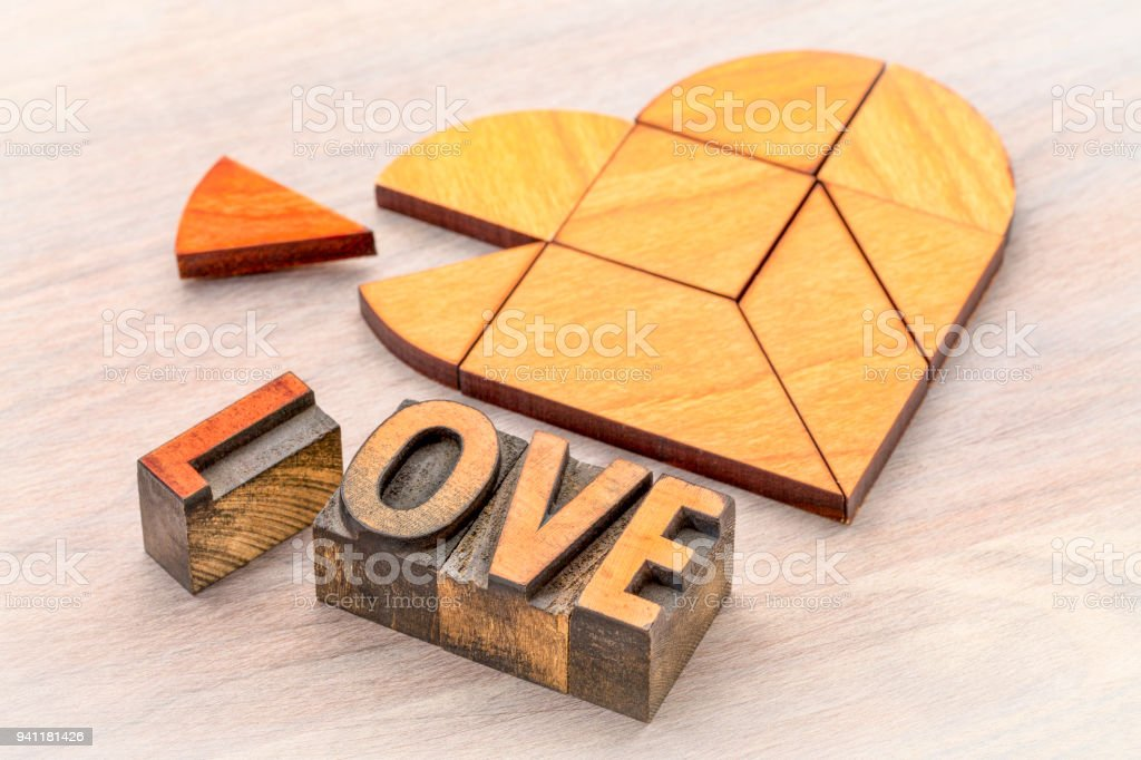 heart tangram puzzle with love word stock photo