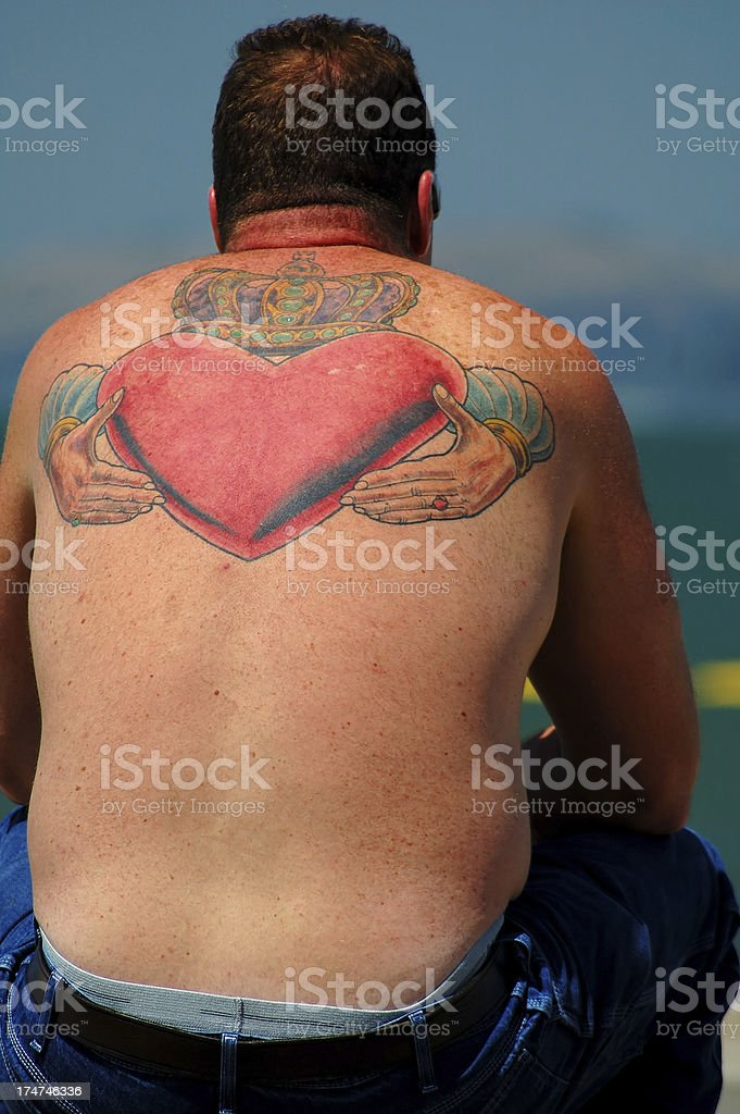 Heart tattoo on the back royalty-free stock photo