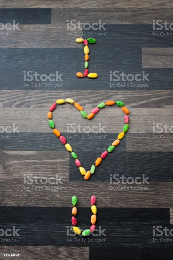 I Heart U made out of colorful rice on a gray kitchen counter to royalty-free stock photo