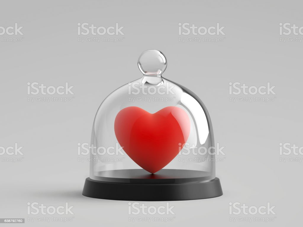 Heart under glass bell jar stock photo