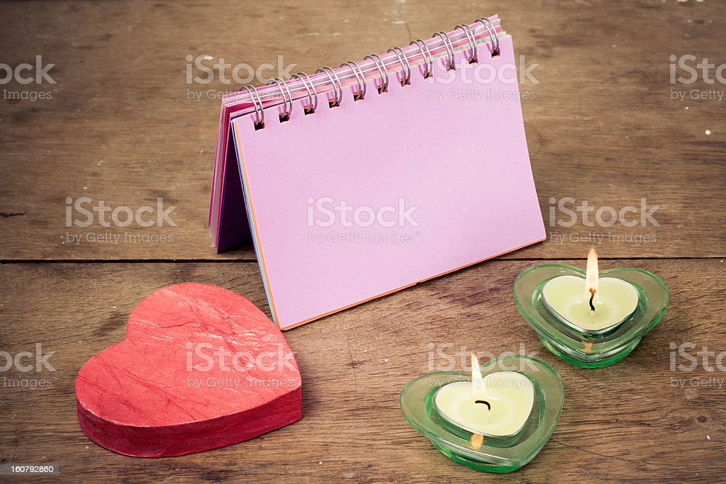 Heart, valentine candles, note paper on wooden background royalty-free stock photo