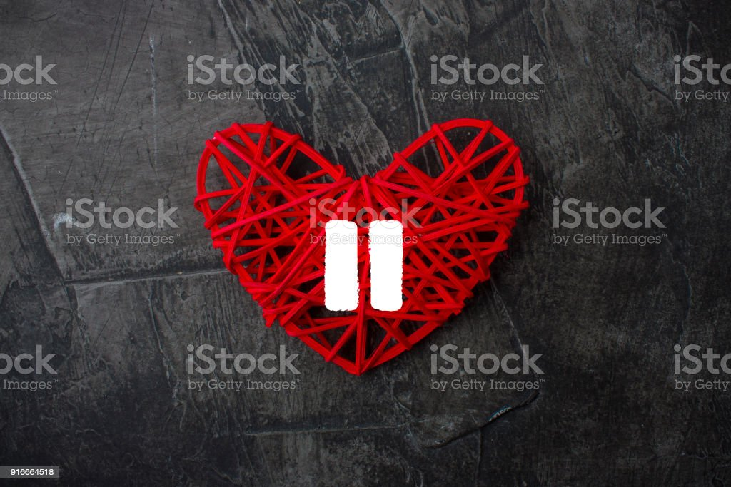 Heart with a sign of Pause on a dark background. Theme for Valentine's Day. Wedding stock photo