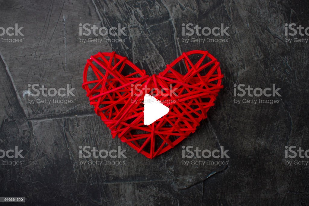 Heart with a sign Play on a dark background. Theme for Valentine's Day. Wedding stock photo