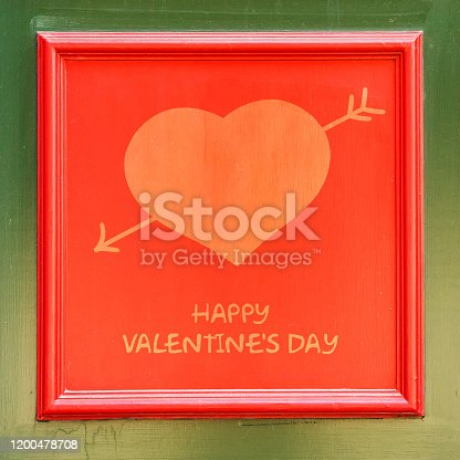 istock Heart with Cupid's arrow in a red frame. Happy Valentine's day background. 1200478708