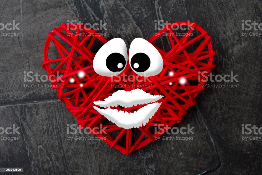 Heart with eyes and mouth stock photo