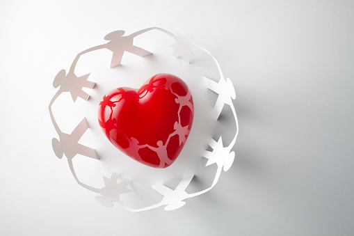 Heart with human paper chain isolated on a white background.