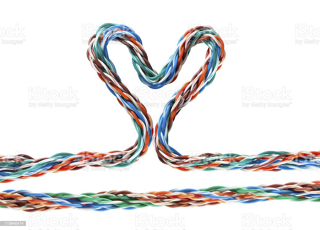 Heart with multicolored computer cable royalty-free stock photo