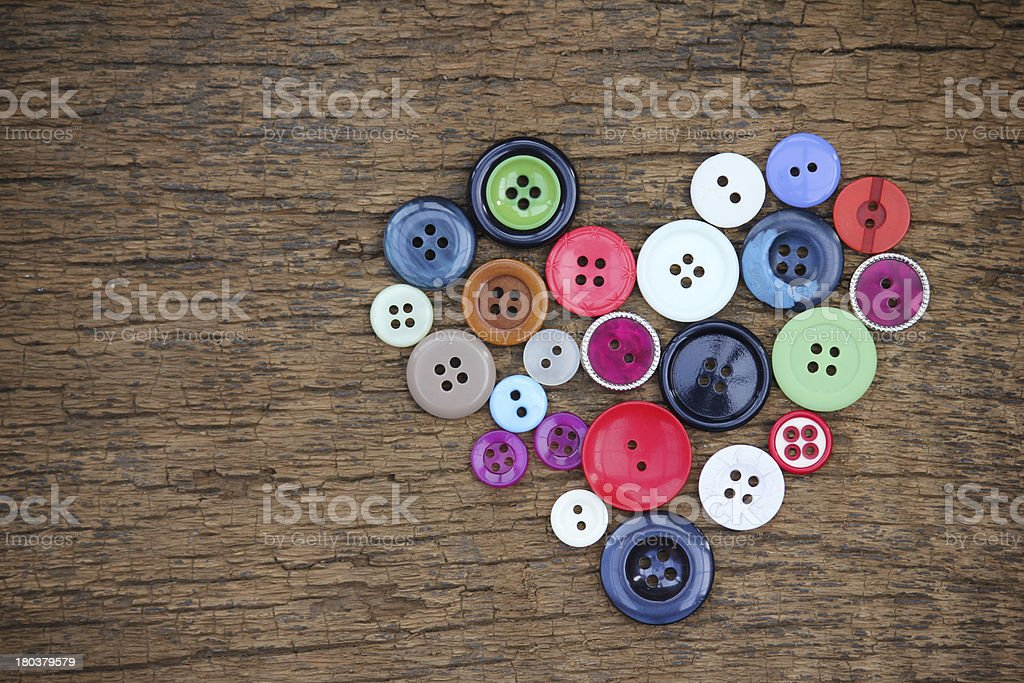 Heart with old buttons royalty-free stock photo