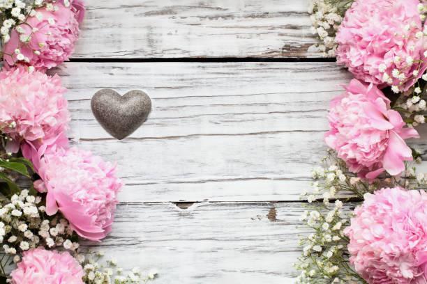 Heart with pink peonies and babys breath flowers over a white wood picture id1189325277?b=1&k=6&m=1189325277&s=612x612&w=0&h=dzs hhtsc5cfp2gyazf3kaqjnivgrcpr71icpyiykv0=