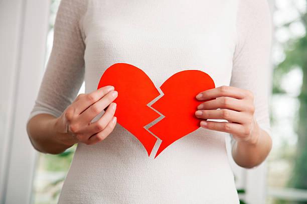 Heartbroken young woman bildbanksfoto