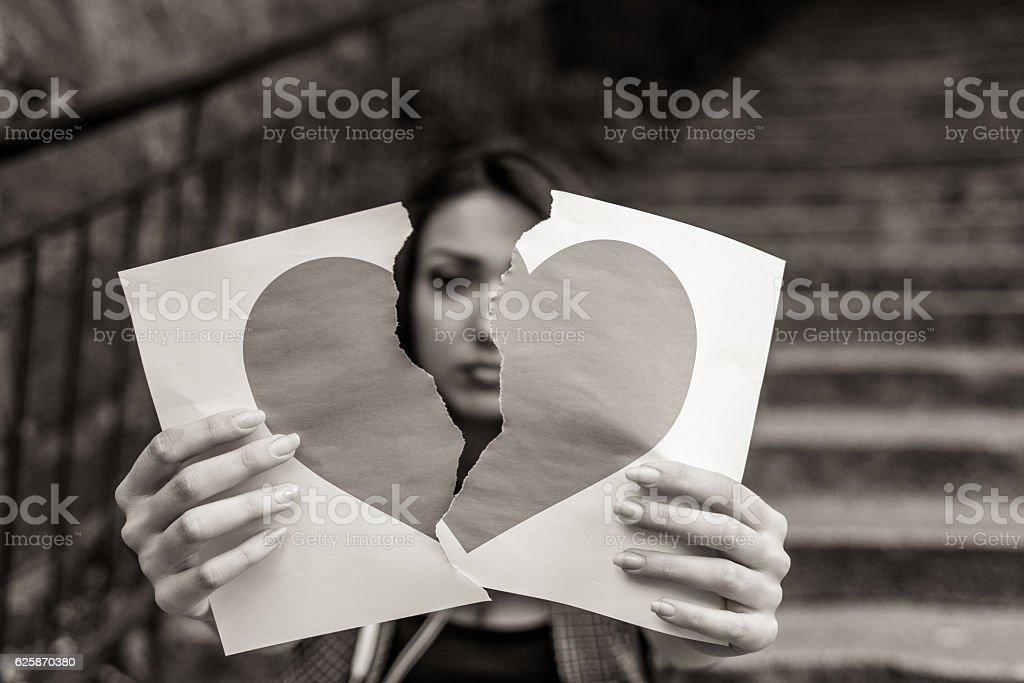 Heartbroken young woman stock photo