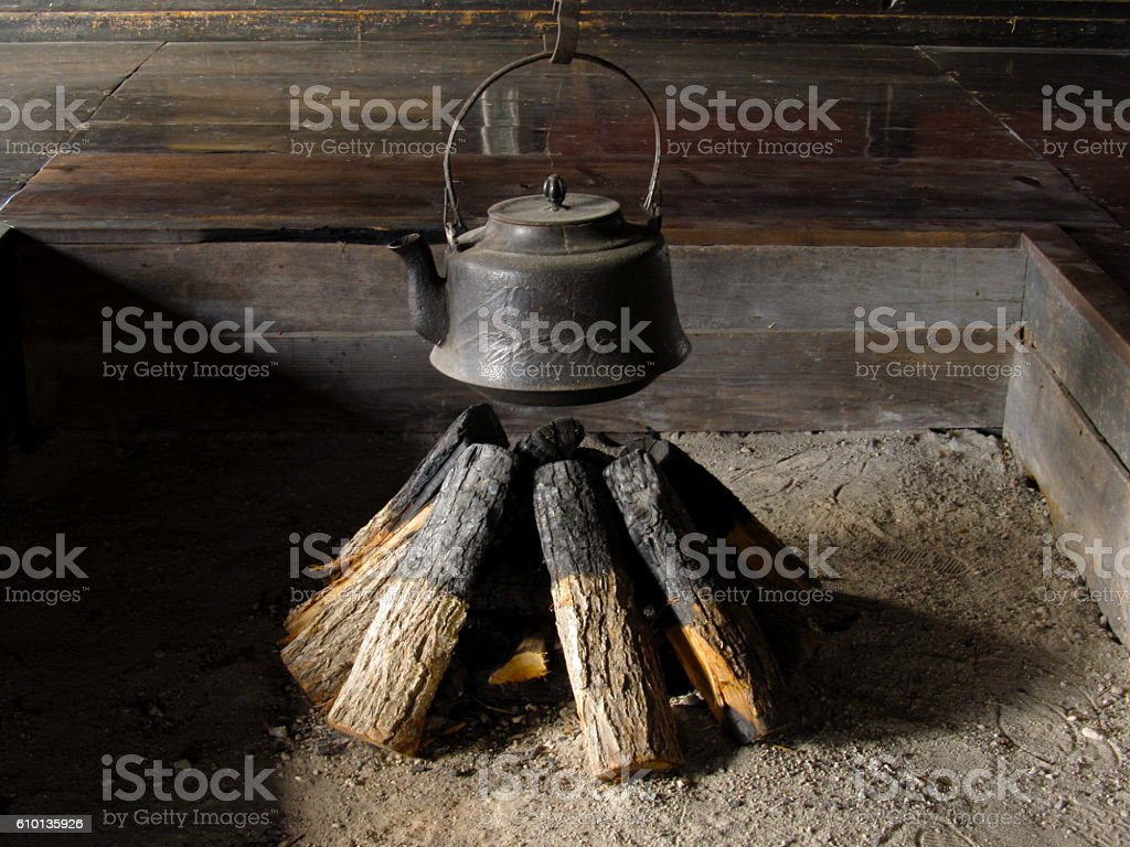 Hearth and iron kettle stock photo