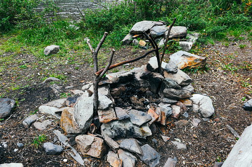 628409126 istock photo hearth of stones for tourist campfire in campsite, outdoor recreation 1229594137