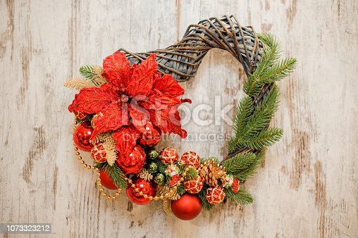 istock Hearth shape christmas wreath with golden and red decoration 1073323212