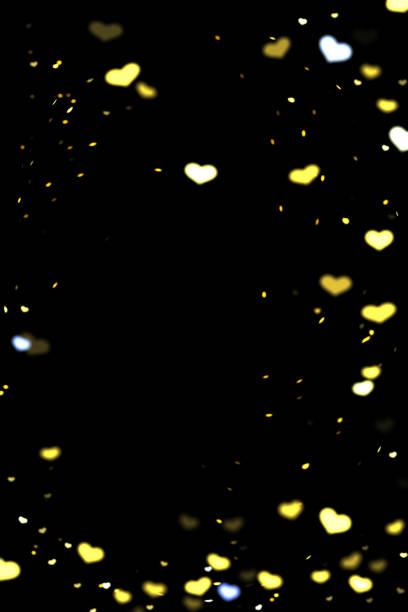 Hearts bokeh overlay, abstract background, shiny gold hearts bokeh stock photo
