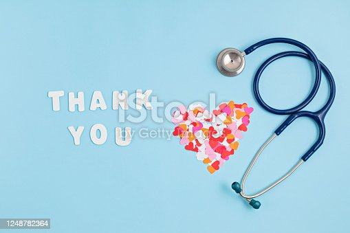 Hearts confetti and text thank you. Expressing gratitude to doctors and nurses idea