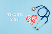 istock Hearts confetti and text thank you. Expressing gratitude to doctors and nurses 1248782364