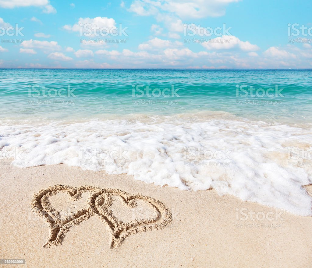 Hearts drawn on the beach. stock photo