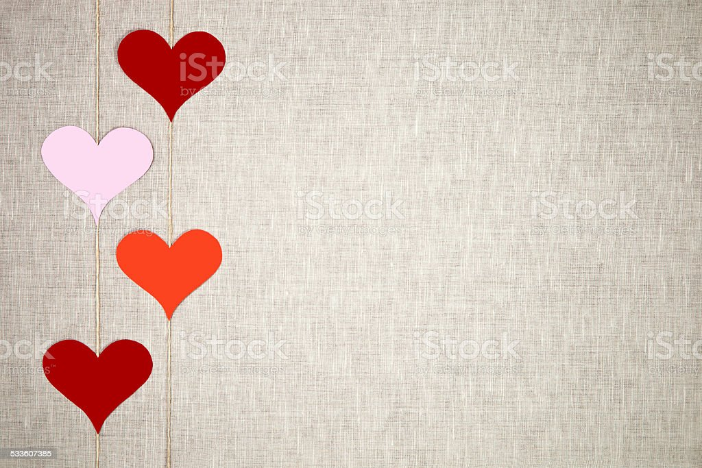 Hearts garlands on linen background stock photo