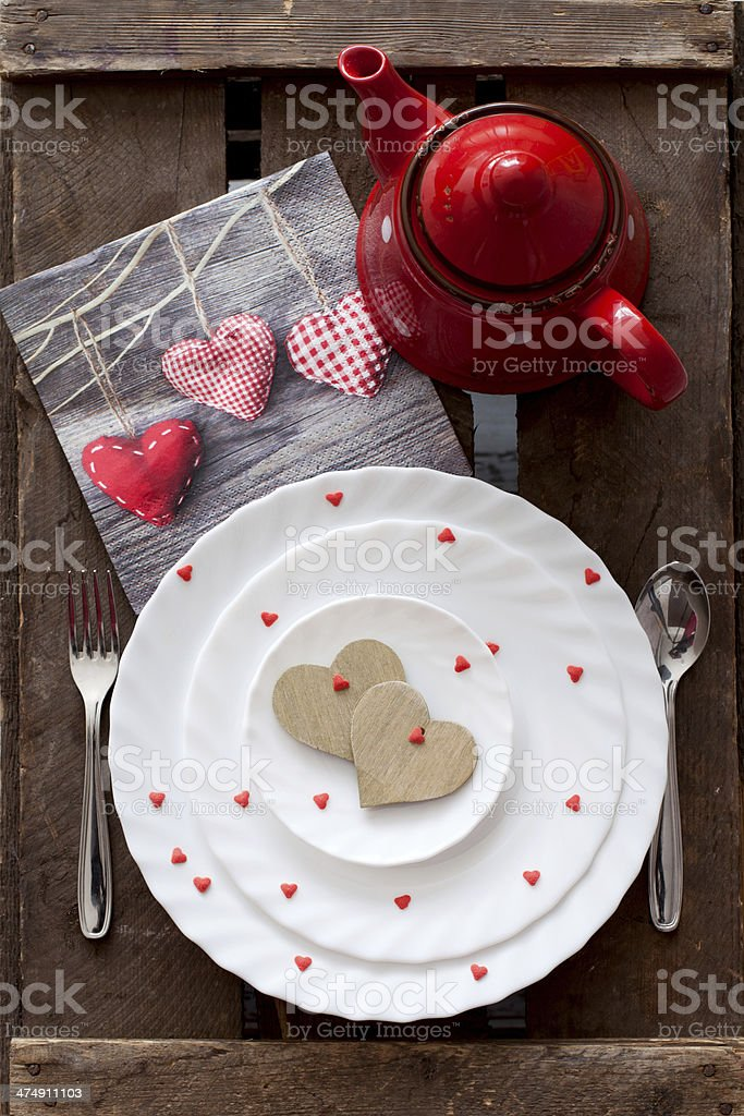 Hearts in a plate and tea stock photo