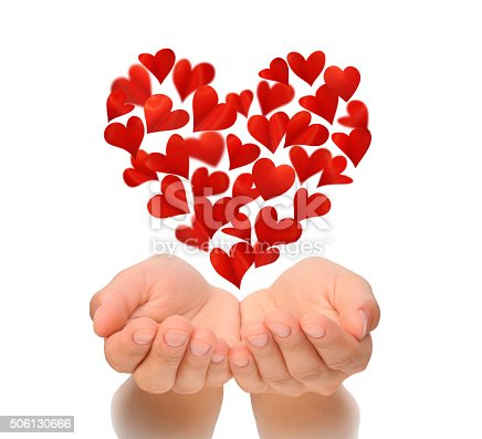 istock Hearts in heart shape flying over cupped hands of woman 506130666