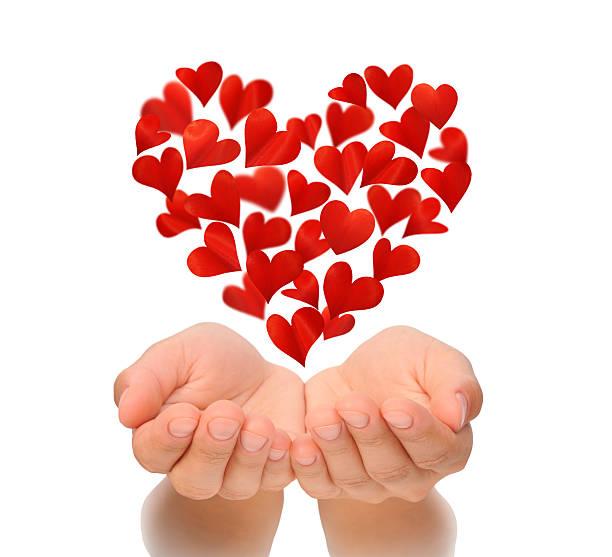 hearts in herzform fliegt über geschlossen hände von frau - foto collage geschenk stock-fotos und bilder