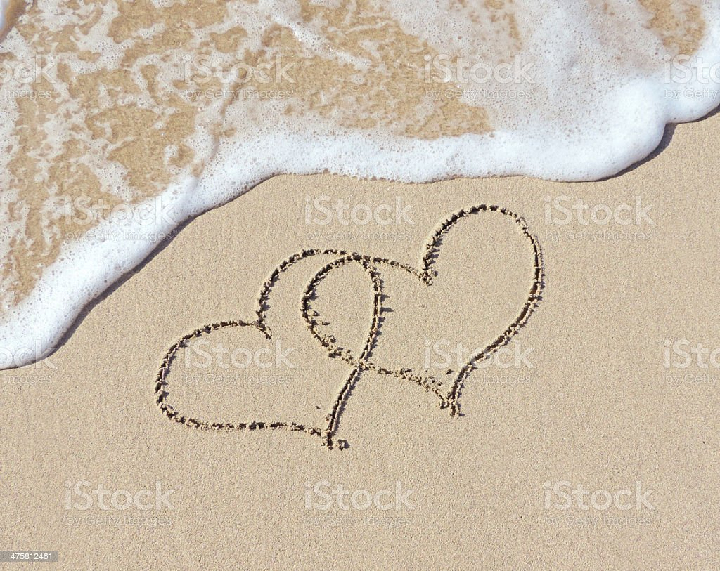 Hearts in the sand stock photo