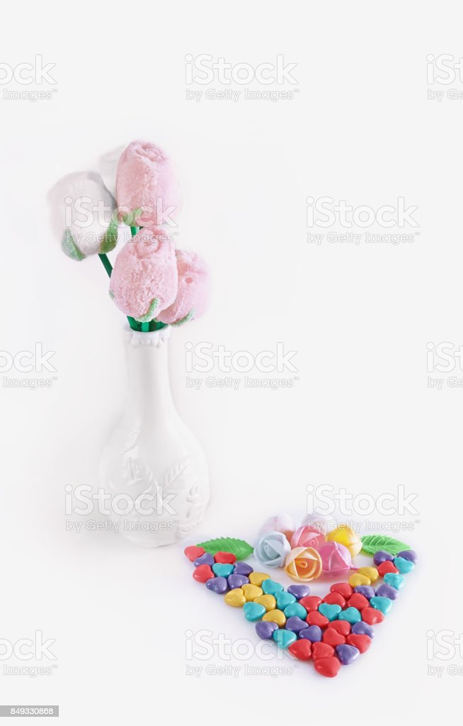 Hearts made of candy on Valentine's day with red basket stock photo