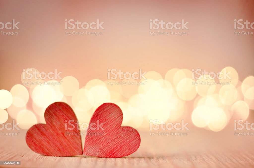 Hearts on a wooden table and background is a bokeh. stock photo
