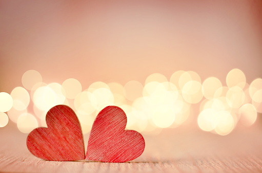Hearts On A Wooden Table And Background Is A Bokeh Stock Photo - Download Image Now