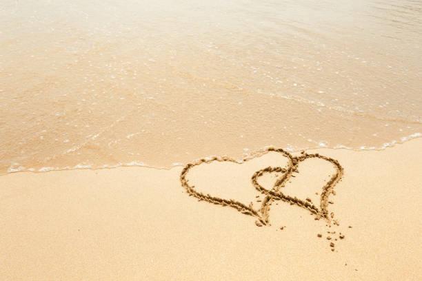 hearts on the beach stock photo