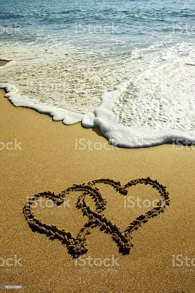 Hearts on the sand stock photo