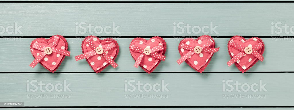 Hearts on wooden background stock photo