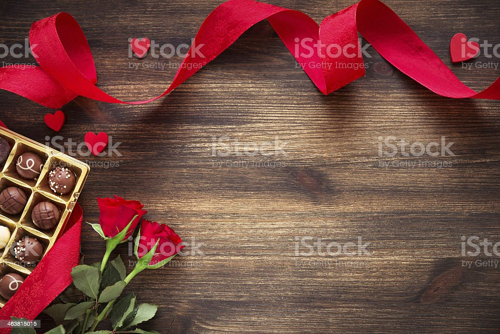 Hearts,chocolate truffles and red roses on wooden background stock photo