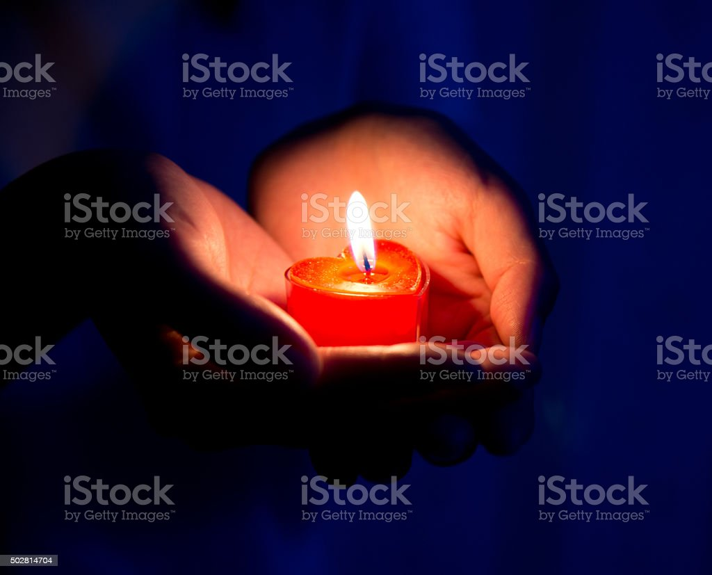 Heart-shaped candle stock photo
